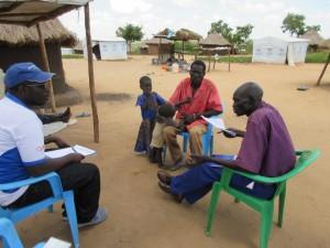 目の不自由な難民(中央の男性)と面会
